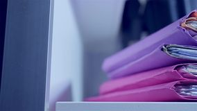 Closeup of a folder stack stock footage