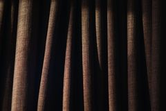 Closeup of folds on curtain with side lighting stock image