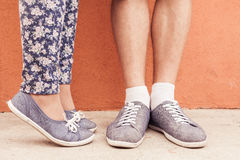 Closeup foot of kissing couple outdoor at street Royalty Free Stock Photography