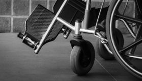 Closeup foot rest and whee of wheelchair. Sad news at the hospital. Depression with aging society. Lonely empty wheelchair. Medical equipment for service stock photography