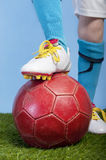 Closeup on foot and soccer ball Royalty Free Stock Image