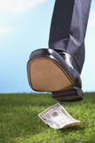 Closeup Of Foot Stepping On Fifty Dollar Bill In Grass Stock Photos