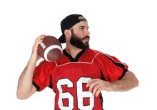 Closeup of a football player with his football in his hand Stock Images