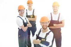 Closeup.the foreman and construction team. Isolated on white royalty free stock photos