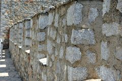 Closeup of Fortress Brick Wall. Closeup of fortress wall at Samuel`s castle in Ohrid, Macedonia.  Details of stone construction. Horizontal photo with leading Royalty Free Stock Photography