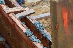 Closeup of foundation excavation with fresh poured concrete Stock Photos