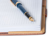 Closeup fountain pen on top of the open notebook Stock Photography