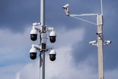 Closeup of four traffic security camera surveillance CCTV on the road in thecity Royalty Free Stock Photos