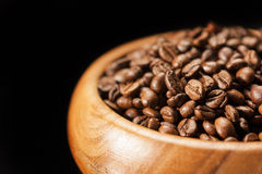 Closeup Fragment of Wooden Bowl with Heap of Coffee Beans. Over Stock Photos
