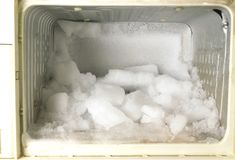 Closeup freezer lost the ice and with some fish in side. Closeup freezer lost the ice and with some fish in side Stock Photography