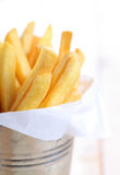 Closeup of French fries in metal cup Royalty Free Stock Image