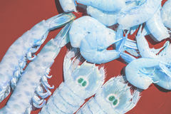 Closeup fresh blue prawns and shrimp. Seafood on green plate Stock Photos