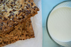 Closeup of fresh cookies with glass of milk Royalty Free Stock Image