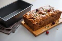 Closeup of fresh cranberry and pumpkin seed loaf Stock Photos