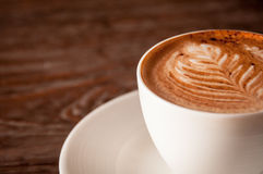 Closeup of a fresh cup of coffee with milk froth Stock Photography