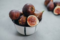 Closeup Fresh figs in bawl on gray background.  stock photography