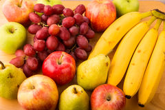 Closeup of fresh fruit on a wood table Royalty Free Stock Photo