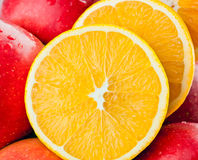 Closeup of fresh fruits: apples and cut oranges Royalty Free Stock Photos