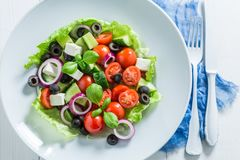 Closeup of fresh Greek salad in white plate Stock Photos