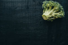 Closeup of fresh green Broccoli on black chalkboard.  Top view, Royalty Free Stock Image