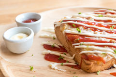 Closeup fresh homemade tuna toast slice baked bread with tomato Royalty Free Stock Images