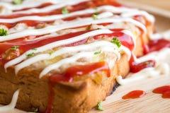 Closeup fresh homemade tuna toast slice baked bread with tomato Royalty Free Stock Image