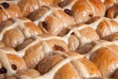 Closeup of fresh hot cross buns baking. Baking fresh hot cross buns closeup Stock Photos