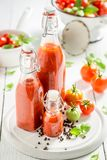 Closeup of fresh ingredients for ketchup made of tomatoes. On wooden table stock image