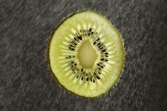 Closeup of fresh kiwi fruit slice Stock Photos