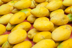 Closeup of fresh mangoes on sale at an Asian fruit market Stock Images