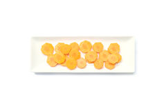 Closeup fresh pile of cut carrot on ceramic square plate isolated on white background , prepare for cook concept with clipping pat Royalty Free Stock Photos