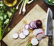 Closeup of fresh radish on wooden cut board Stock Photos