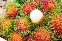Closeup fresh rambutans in wooden box. Tropical fruit of summer. Season. Sweet taste royalty free stock photography