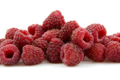 Closeup of fresh raspberries. Over white background Royalty Free Stock Images