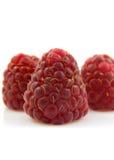 Closeup of fresh raspberries. Over white background Stock Photos