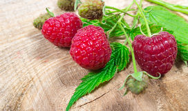 Closeup of fresh raspberries. Closeup of fresh raspberries on a wooden background Royalty Free Stock Photo