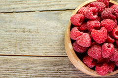 Closeup of fresh raspberries. In a wooden tub Stock Image