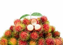 Closeup of fresh red ripe rambutan Nephelium lappaceum. With leaves isolated on white background. Thai dessert sweet ts. Tropical t Stock Images