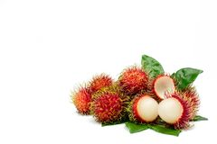 Closeup of fresh red ripe rambutan Nephelium lappaceum. With leaves isolated on white background with clipping path. Thai dessert sweet fruits. Tropical fruit Stock Photos