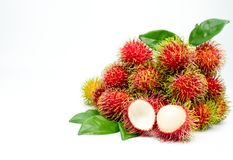 Closeup of fresh red ripe rambutan Nephelium lappaceum. With leaves isolated on white background. Thai dessert sweet fruits. Tropical fruit Royalty Free Stock Photography