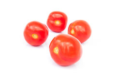 Closeup fresh red tomatoes on white background Stock Image