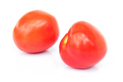 Closeup fresh red tomatoes on white background Royalty Free Stock Image