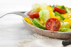 Closeup of fresh salad bowl on table for healthy eating Stock Photos