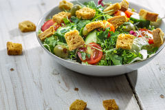 Closeup of fresh salad with croutons and chicken Stock Images