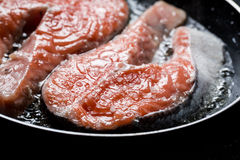 Closeup of fresh salmon in the pan. On black rock Royalty Free Stock Photos