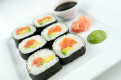 Closeup of fresh salmon sushi maki rolls with ginger, wasabi and soy sauce Stock Photo