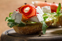 Closeup of fresh sandwiches made of parma ham and brie cheese Royalty Free Stock Photos