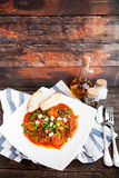 Closeup of fresh shrimp creole with bread on rustik background Royalty Free Stock Photography