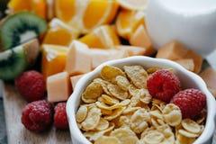 Closeup Fresh sliced fruit: raspberry, kiwi, melon, oranges and Royalty Free Stock Photos