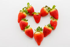 Closeup of fresh strawberries in heart shape Royalty Free Stock Image